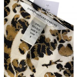 שמלת מקסי שרוול קצר בצבע שמנת עיטורים בגוון חום שחור וכיווץ במותן ובתחילת השרוול diane von furstenberg 4